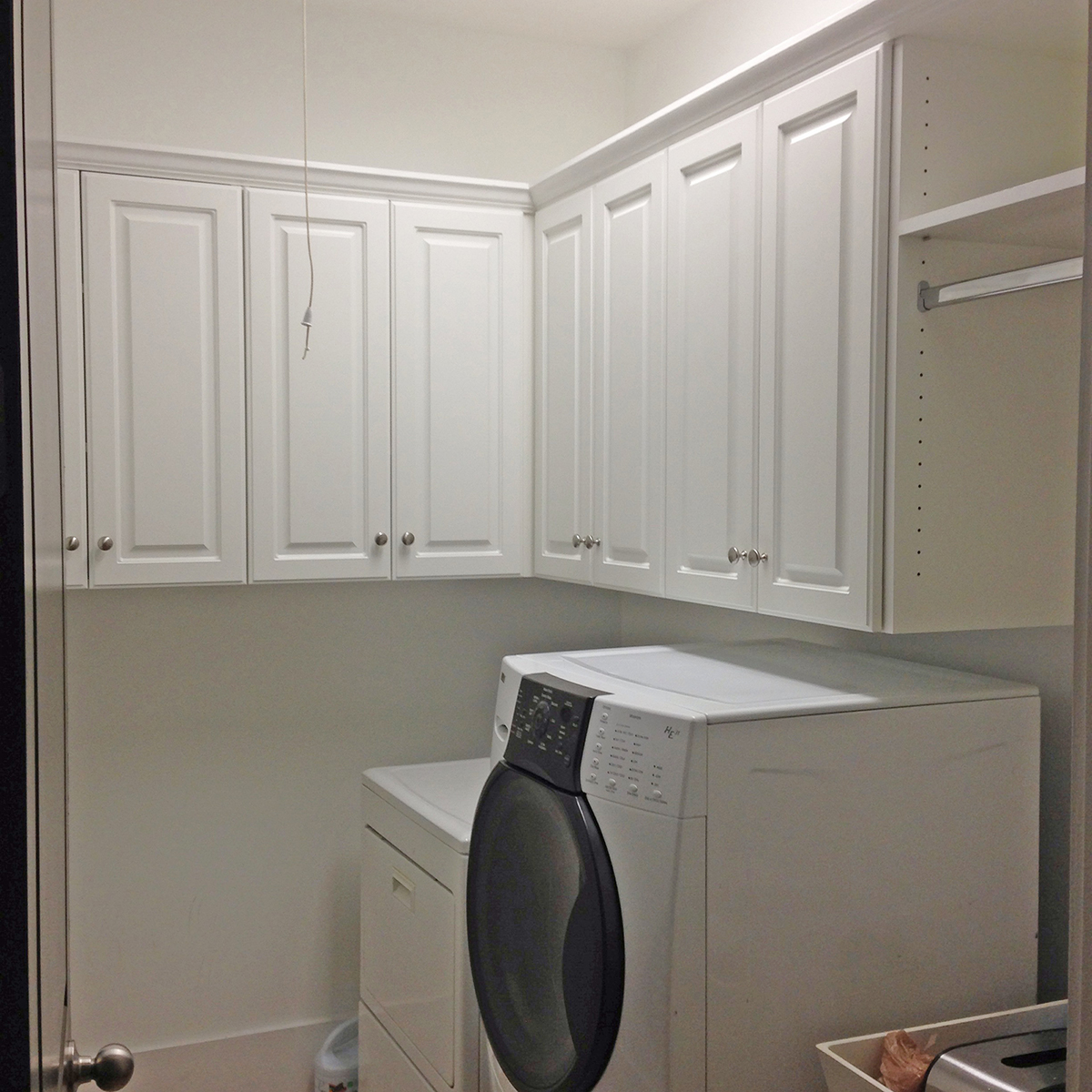 Fill Tiny Room with Clean White Laundry Room Cabinets and Modern Washing Machines