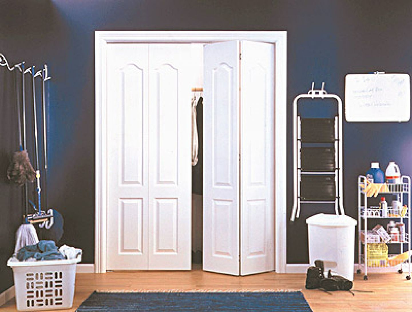 Folded Closet Door Painted In White To Create Black And White Color Scheme  With Wooden Floor