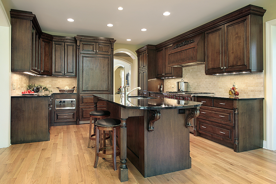 Granite Top on Wooden Island Placed inside Elegant Kicthen with Wooden Kitchen Cabinet Ideas and Round Stools