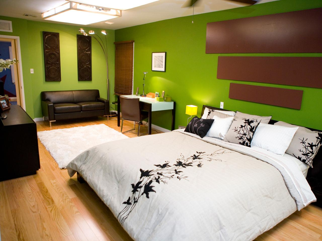 Green Bedroom Paint Colors for Wide Bedroom with Fascinating Bed and White Desk on Hardwood Flooring