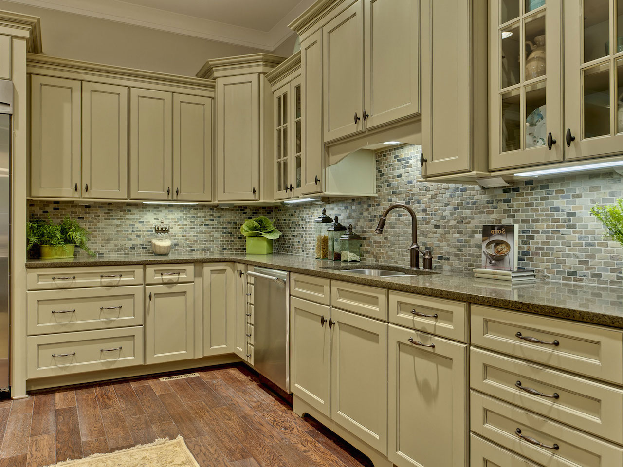 Grey Tile Backsplash and Interesting Painted Kitchen Cabinets Placed in Old Fashioned Kitchen with Hardwood Flooring