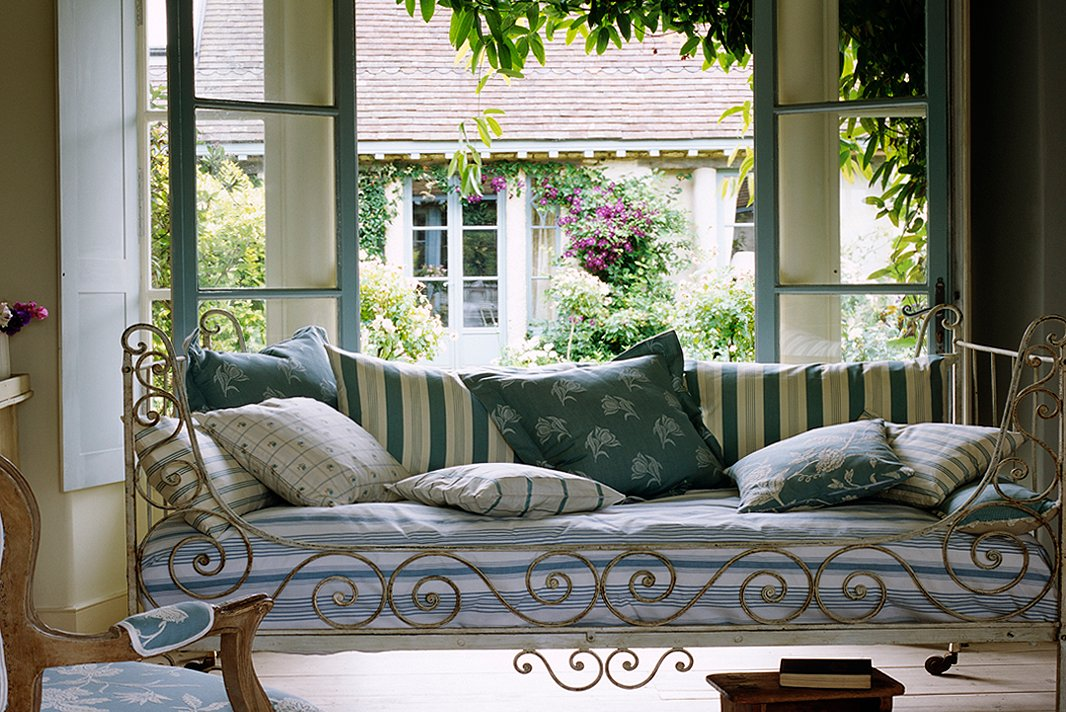 Identical French Style Sofa with Patterned Pillows Strengthening the Decoration