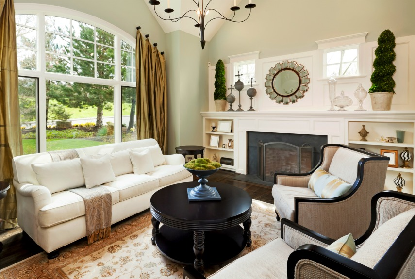 Impressive Living Room Decor with Wide Fireplace and Black Round Table near Long White Sofa