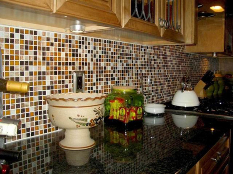 Impressive Mosaic Tile for Kitchen Backsplash Working with Black Countertop and Wooden Cabinet