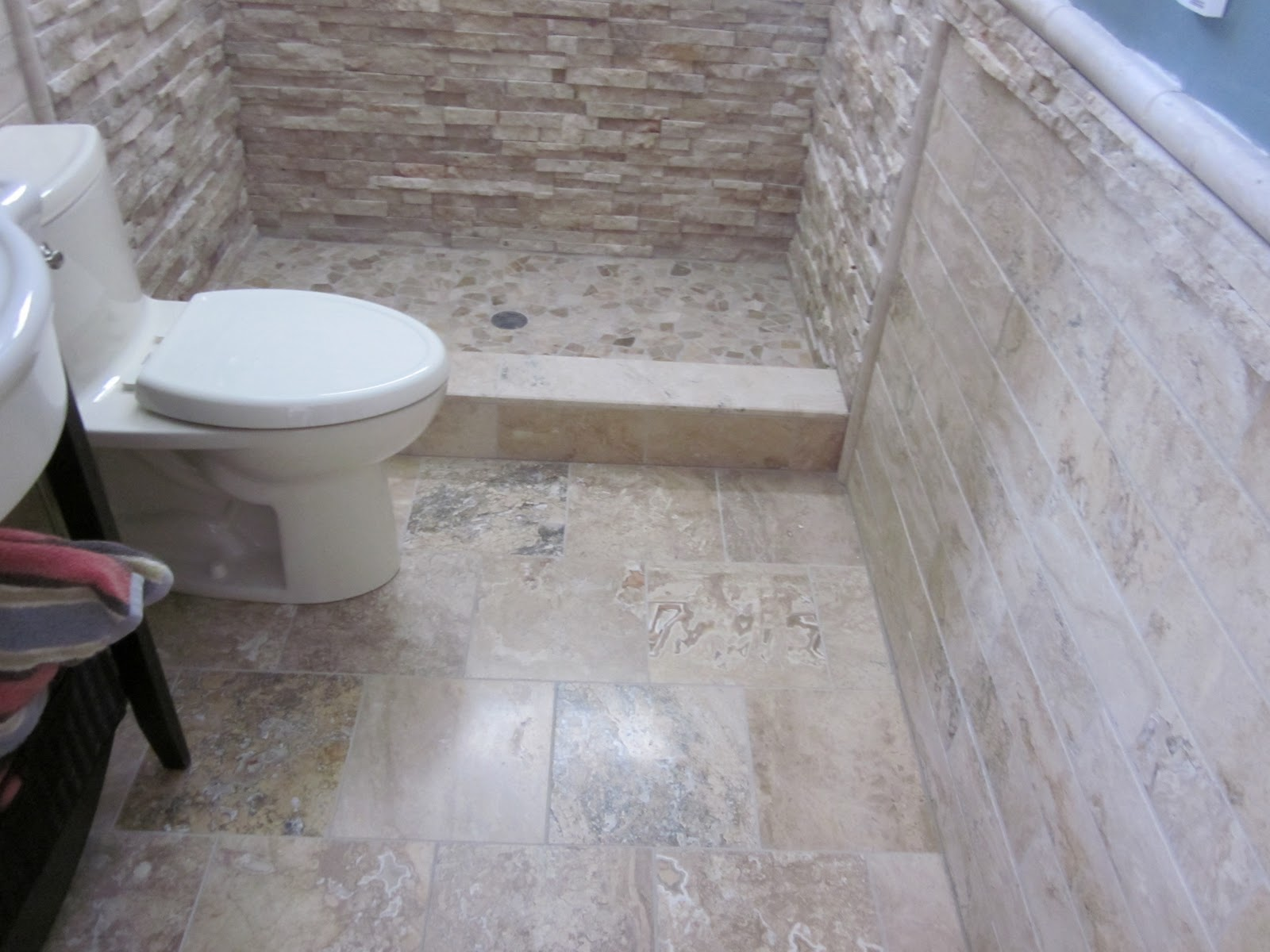 Impressive Natural Accents for Small Bathroom Remodeling Idea with Rough Stone Shower Wall