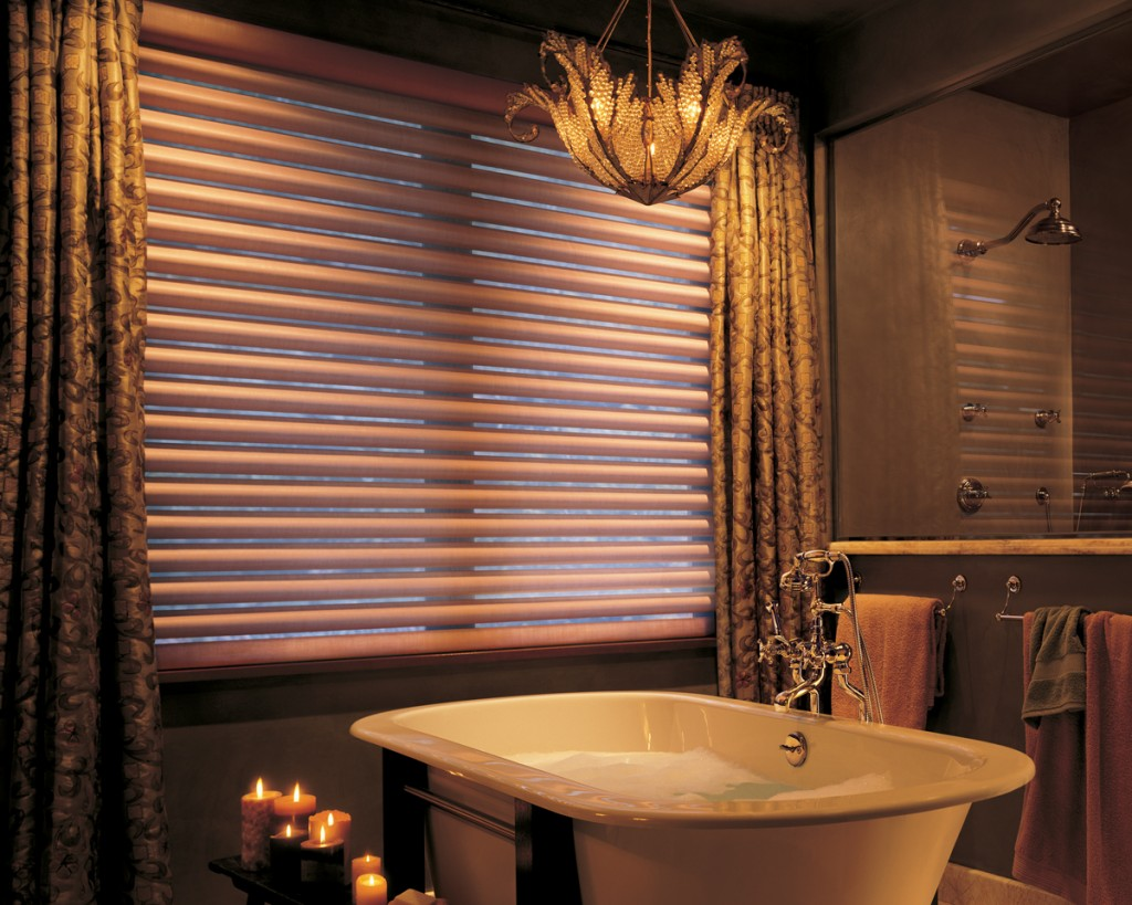 Install Gorgeous Ceiling Lamp above Classic Bathtub and Glossy Faucet near Elegant Brown Bathroom Window Curtains