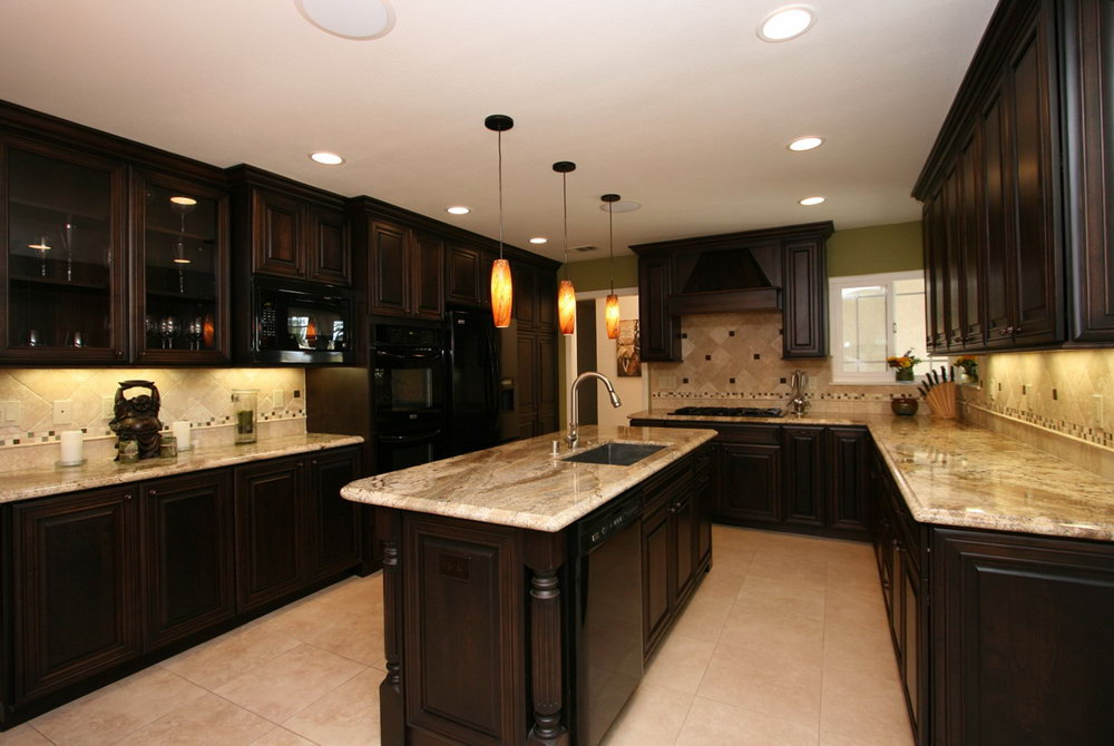 Interesting Black Kitchen with Marble Countertop Matched with Cream Ceramic Tile Backssplash with Pattern