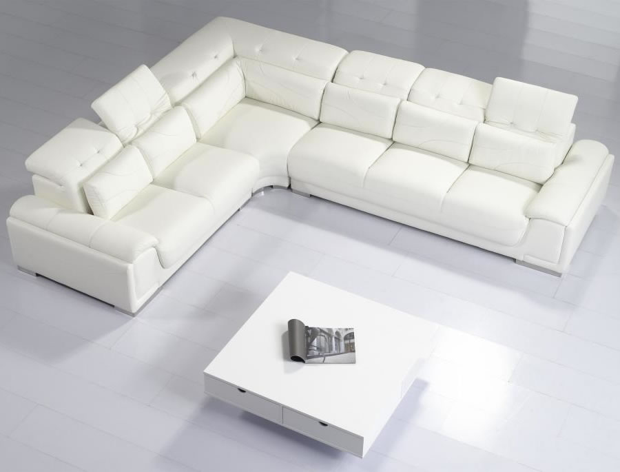 Interesting White Coffee Table and Modern Sectional Sofas on White Lmainate Flooring for Stunning Room