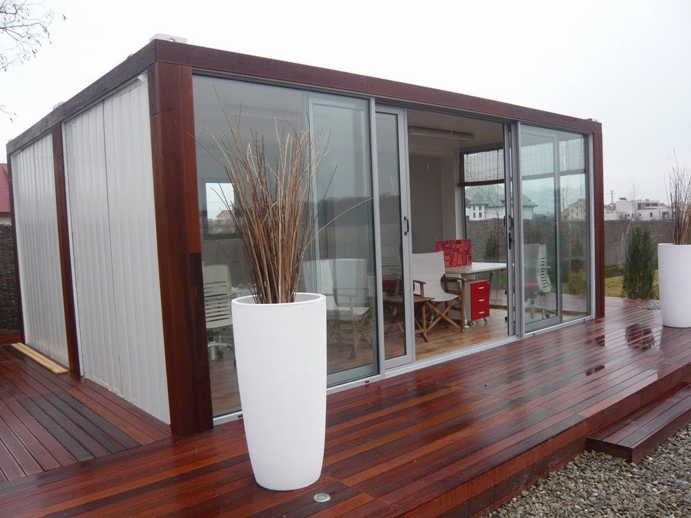 Laminate Oak Flooring and Wooden Deck Decorating Small Storage Container Homes with Glass Wall and Wide Sliding Door