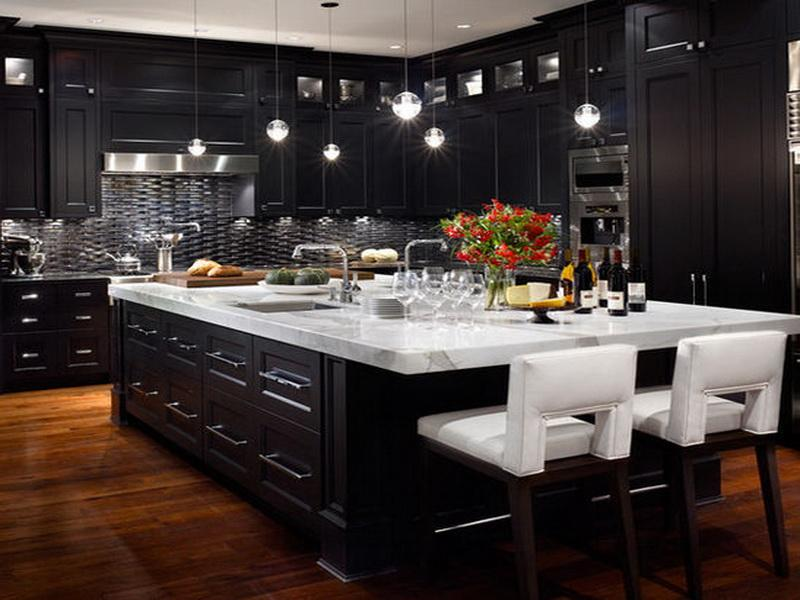large kitchen island with marble countertop decorated with pendant lamps to work with black cabinets - Black Kitchen Cabinets Pictures