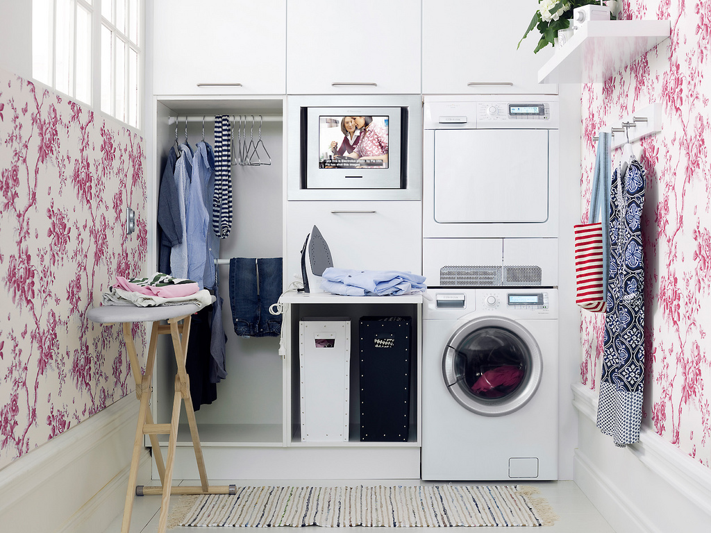 lovely flowery wallpaper as brilliant laundry room decor with stacked washing machines and cabinets - Laundry Room Decor