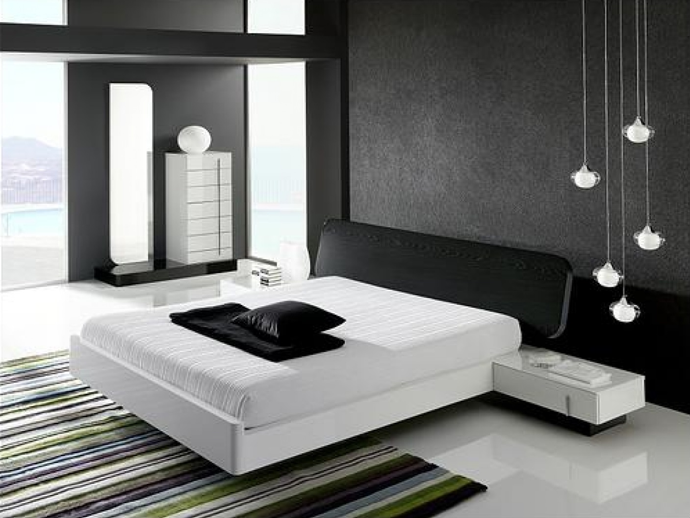Minimalist Black and White Bedroom with Floating Bed and Colorful Rug for Decoration