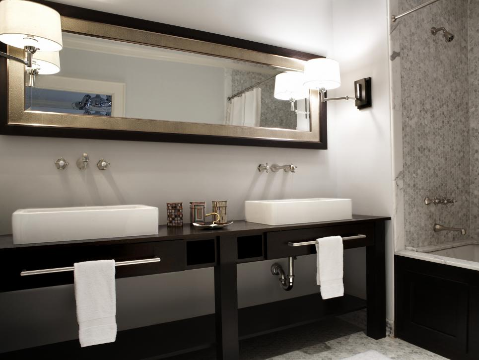 Modern Bathroom Vanity with Black Furniture and White Sinks and Towels