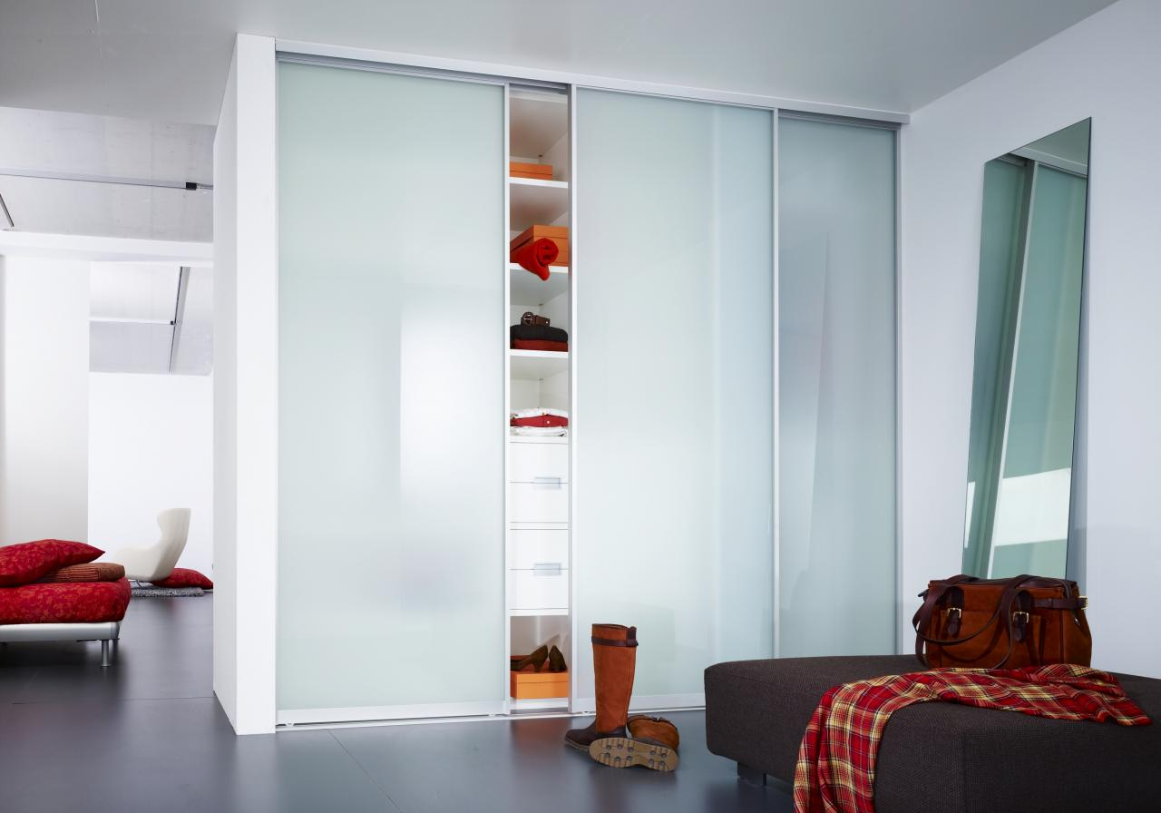 Modern Glass Sliding Closet Door to Balance Freestanding Mirror Next to It