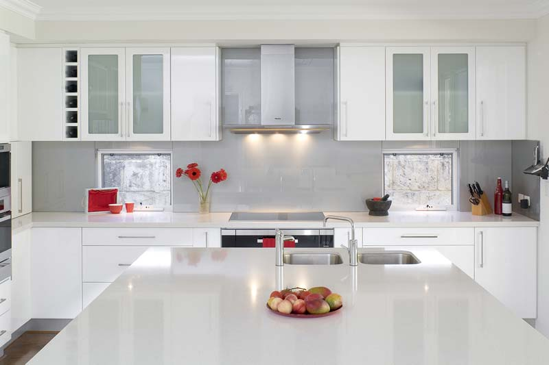 Modern White Kitchen With Grey Backsplash Showing Calm Character And Cozy Nuance