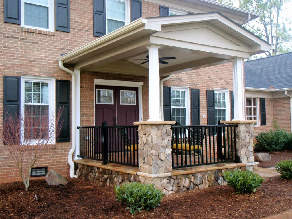 Natural Stone Pillars and Black Fence for Tiny Front Porch Ideas with Metal Chairs and Yellow Seat Lathes