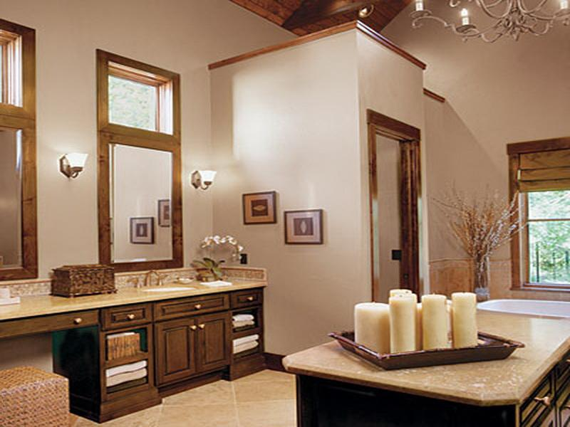 Neutral Bathroom Interior Decorated with Beautiful Flowers and Romantic and Soothing Candles