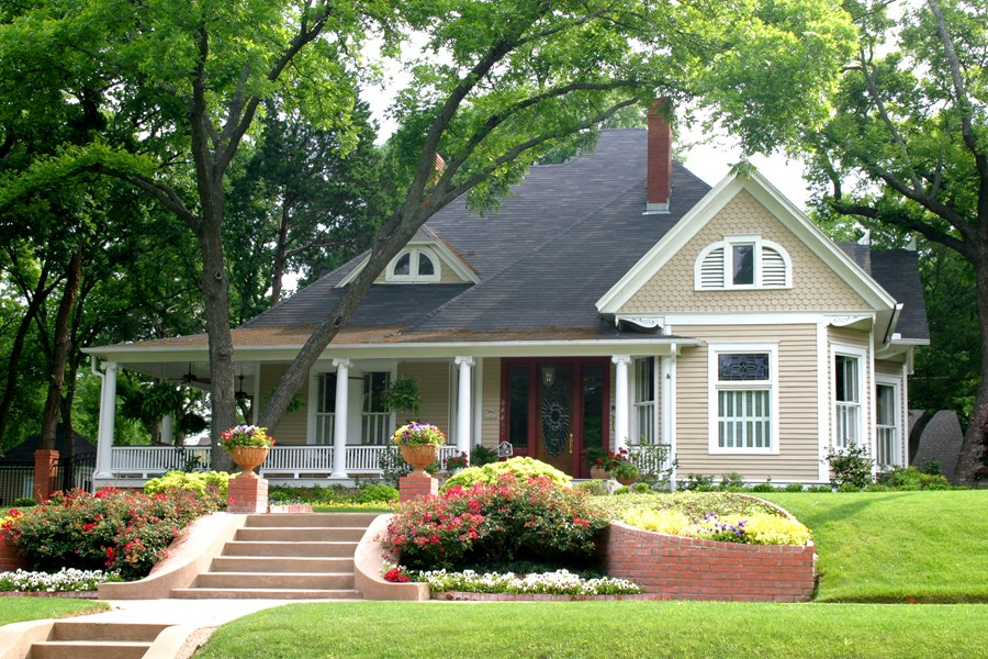 Old Fashioned House Facade Completed with Beautiful Front Yard Landscaping using Colorful Flowers
