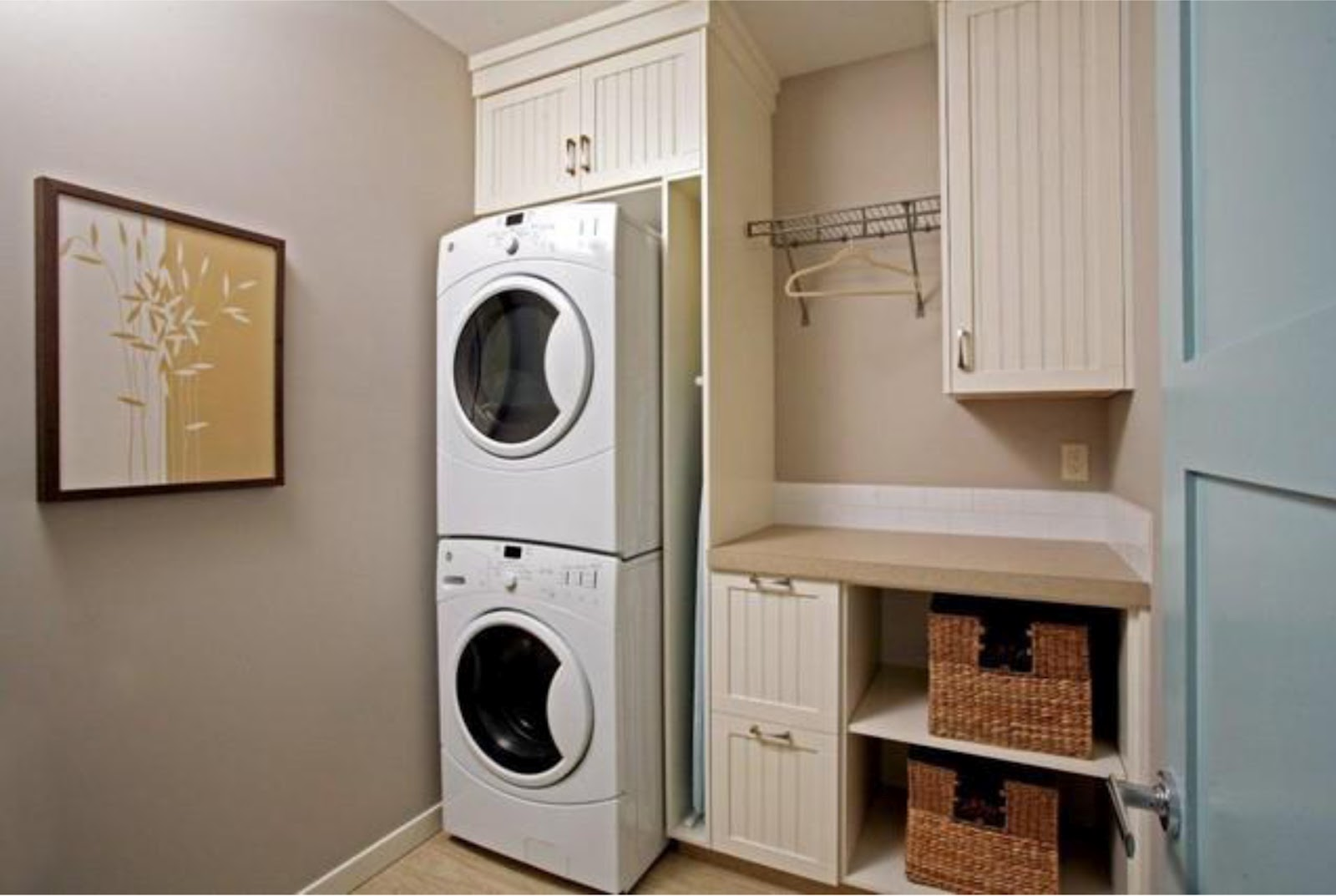 Old Fashioned Laundry Room Cabinets Completing Small Area with Wicker Baskets and Stacked Washing Machines