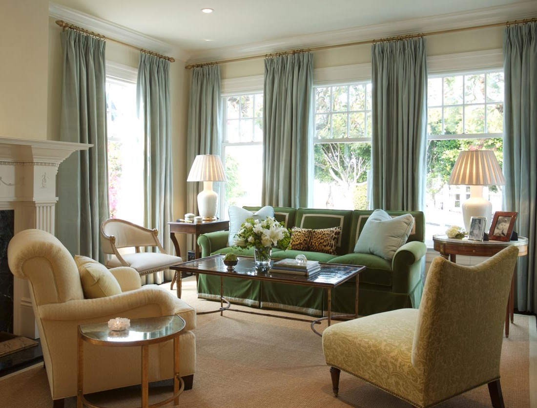 Old Fashioned Sitting Area with Green Sofa and Fluffy Chairs near Grey Living Room Curtains