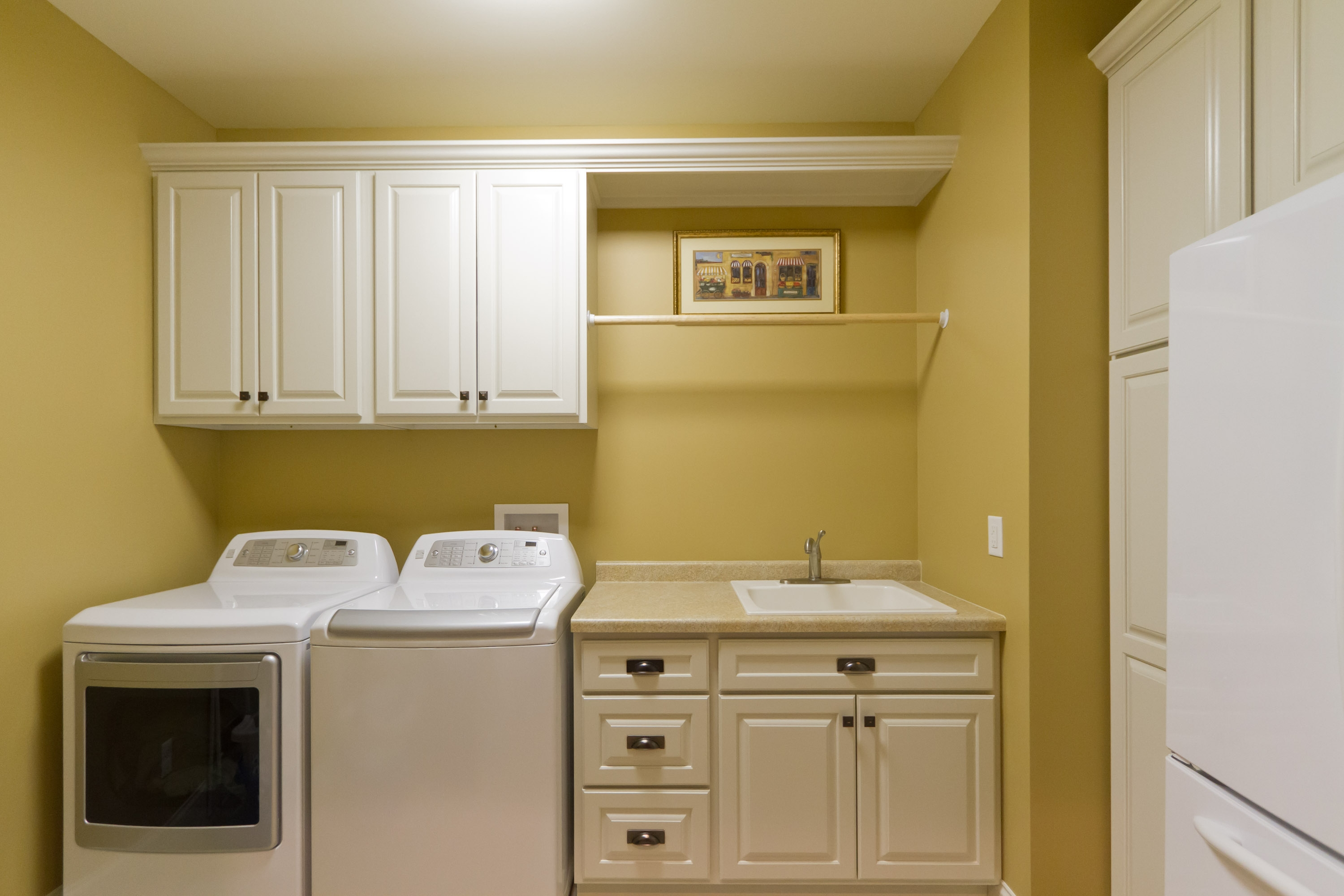 Old Fashioned Washing Machines and White Sink under White Cabinets inside Small Laundry Room Decor