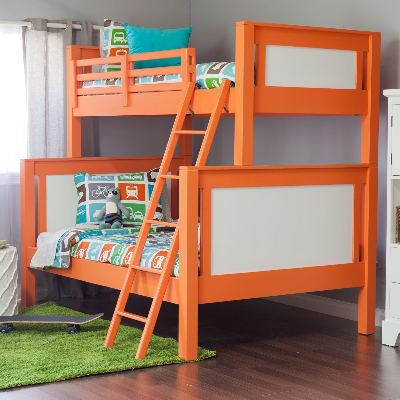 Orange Toddler Bunk Beds with Ladder and Transportation Themed Bedding for Cozy Boys Bedroom