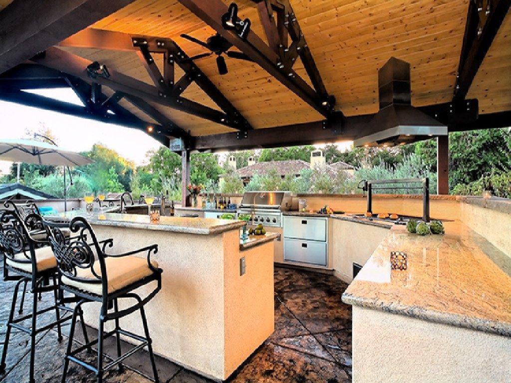 Outdoor Kitchen Ideas with Direct Connection to Landscape and Swimming Pool