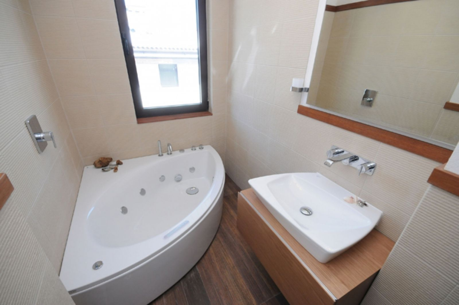 Perfect Corner Tub and Tiny Floating Vanity with Single Sink of Small Bathroom