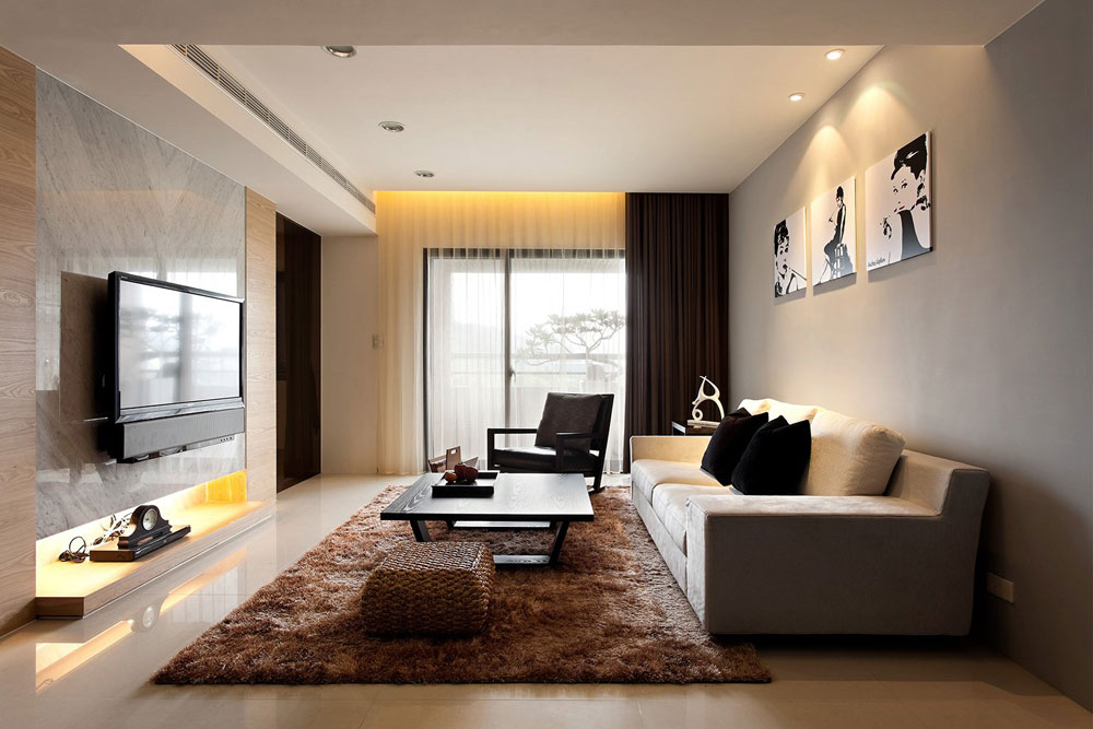Place Brown Carpet inside Contemporary Living Room Design with Dark Coffee Table and Wicker Ottoman