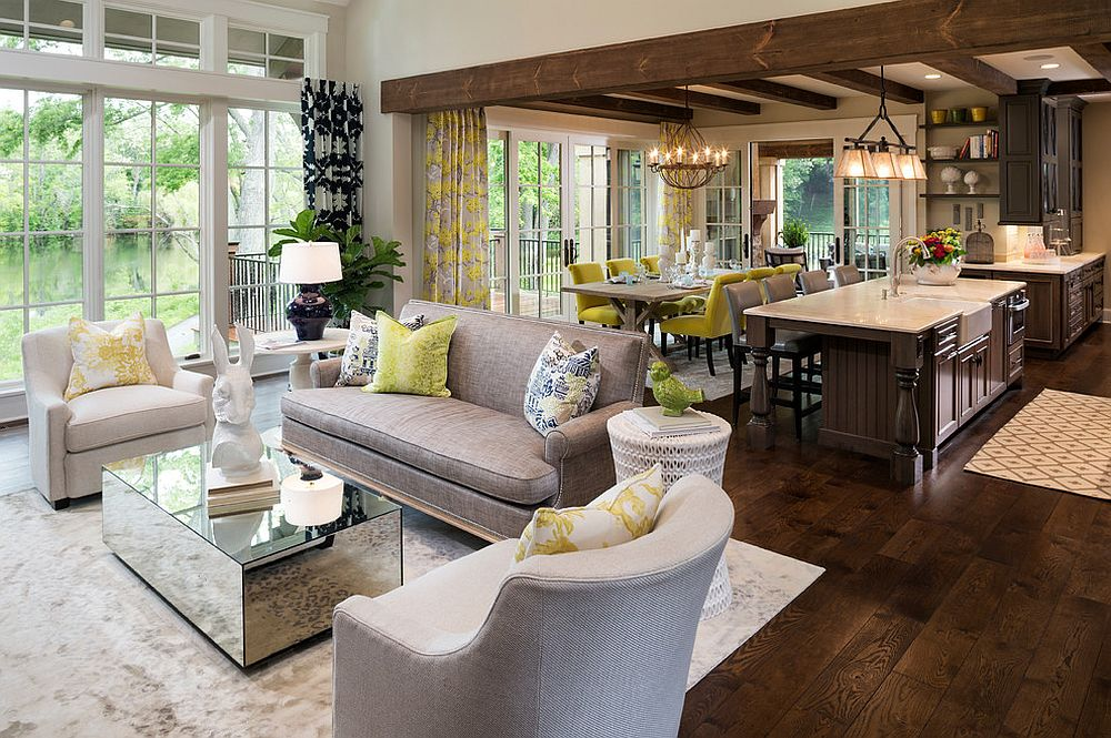 Place Grey Sofas and Mirrored Coffee Table in Cozy Family Room using Open Floor Plans with Classic Kitchen