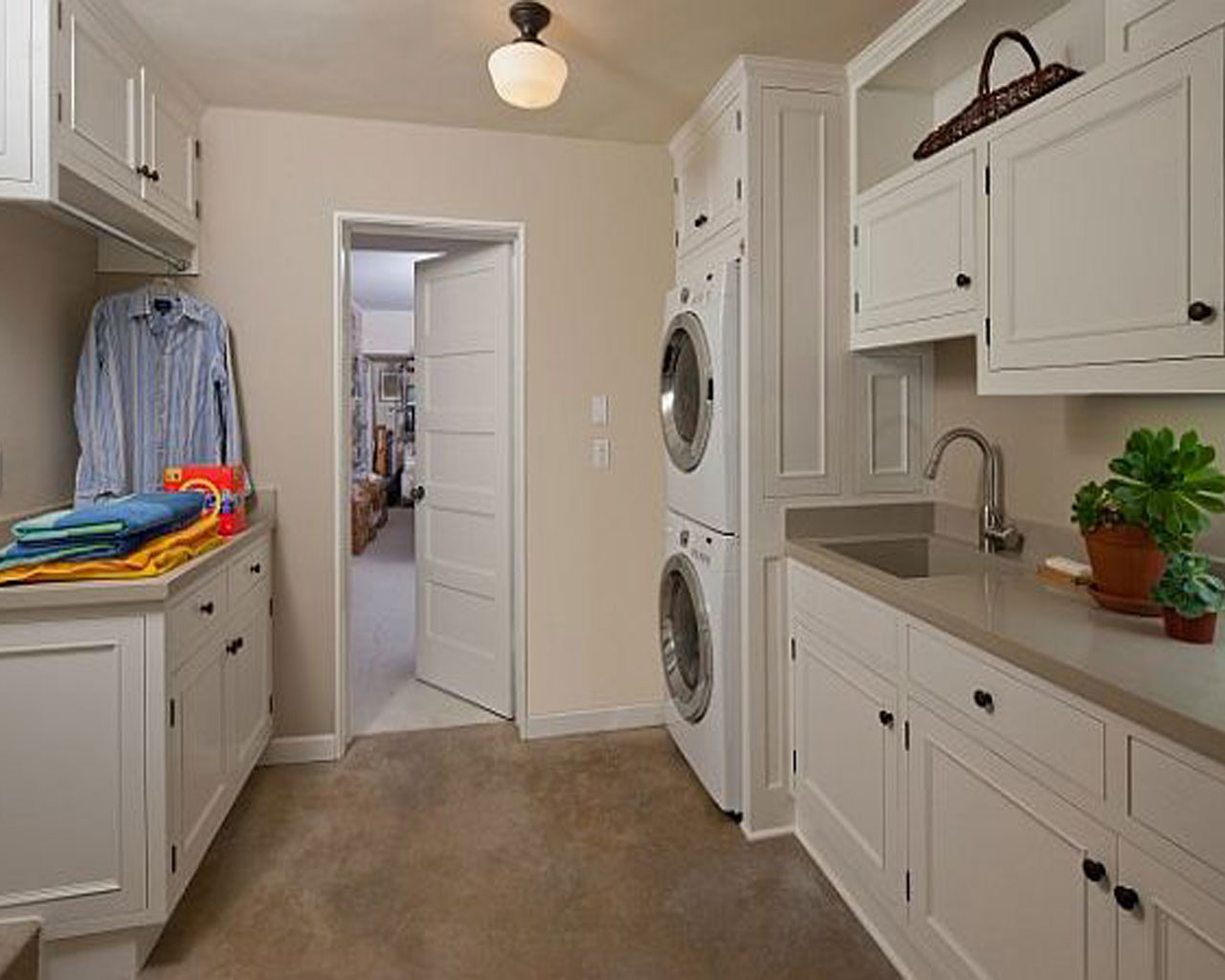 Place Stacked Washing Machines in High Shelf for Small Laundry Room Ideas with White Counter