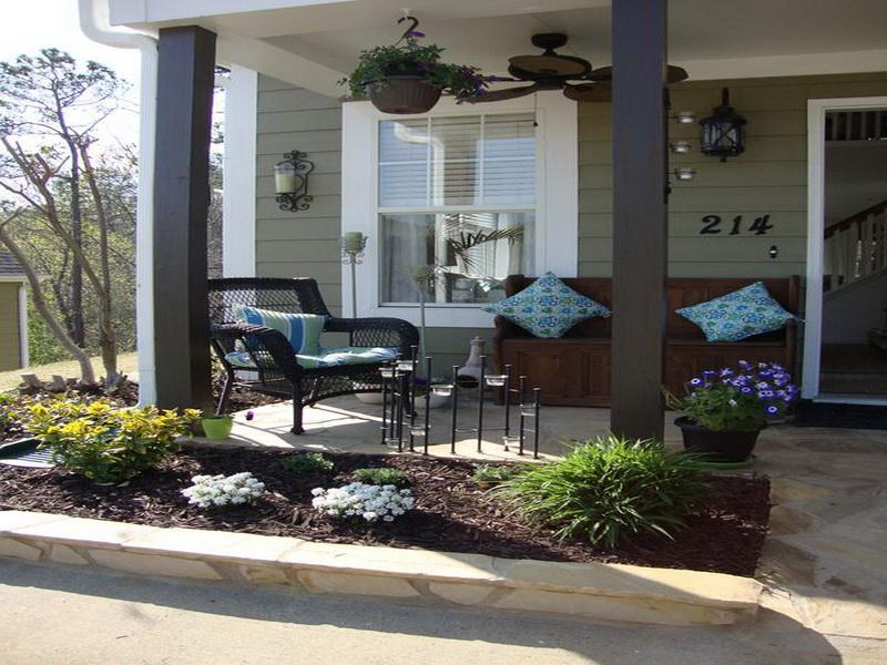 Place Wicker and Wooden Benches in Old Fashioned Front Porch Ideas with Stone Tile Flooring