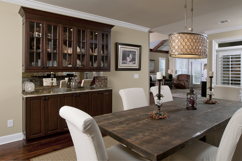 place wooden cabinets for spacious dining room ideas with rustic dining table and white chairs