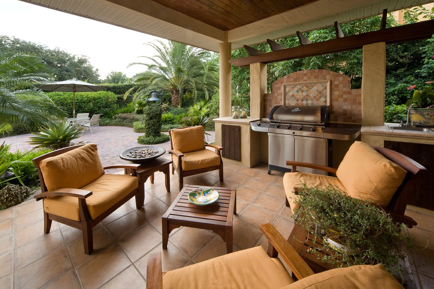 Place Wooden Living Spaces Furniture for Old Fashined Patio with Barbeque Counter and Stone Flooring