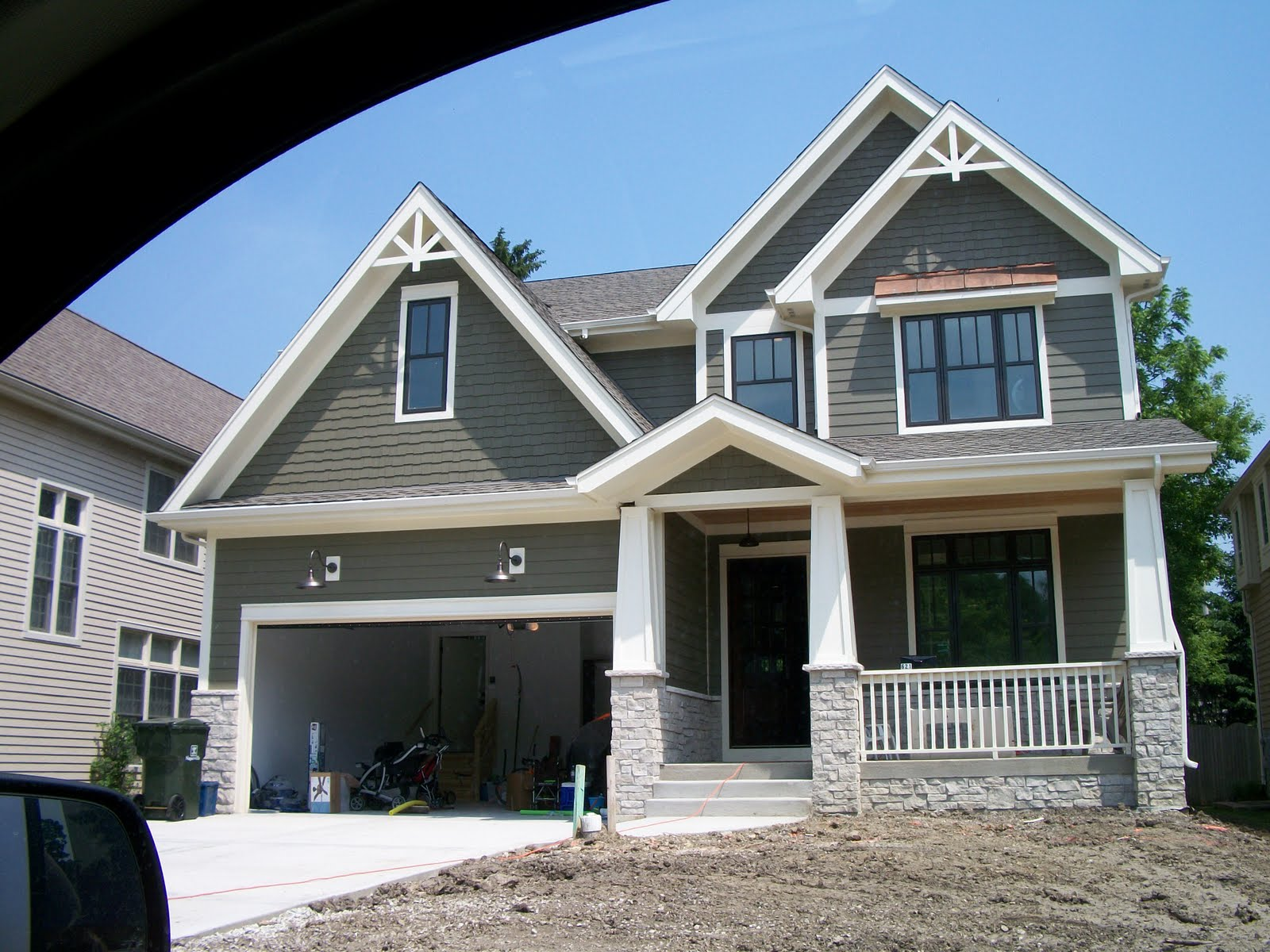 Popular Grey And White Exterior Paint Colors Supported With Stone Accent Shingled Wall