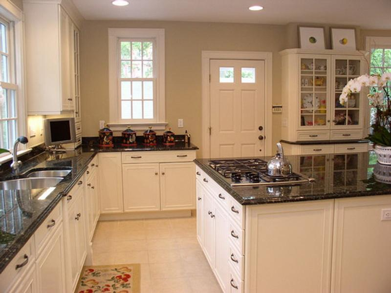 Popular Kitchen Paint Color in Grey with White Kitchen Cabinets and Black Countertop