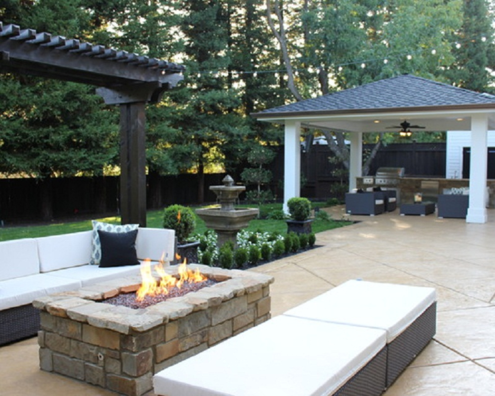 Practical Backyard Patio Ideas with Sectional Sofa and Bench Completed with Fireplace between Them