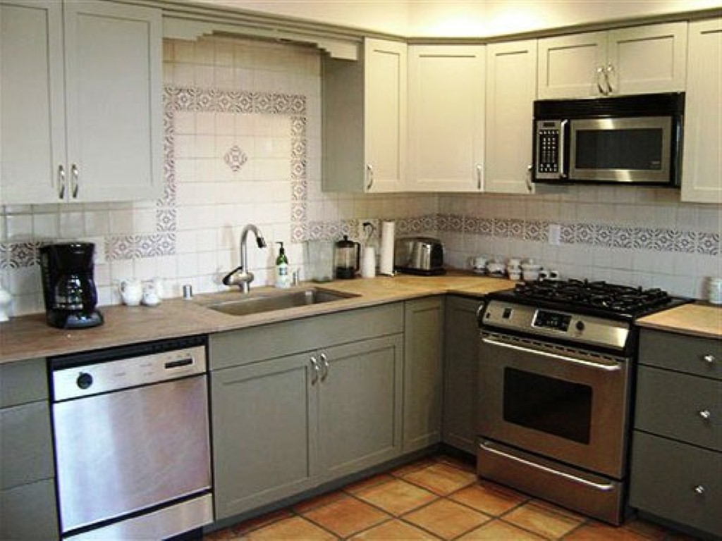 Refinished Kitchen Cabinets In Grey Finisihg With New Handles And Patterned  Backsplash