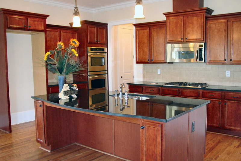 Refinished Wooden Kitchen Cabinets to Look More Impressive with Decorative Sun Flowers
