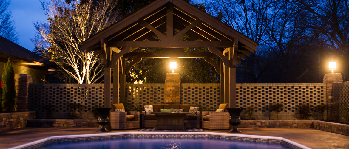 Relaxing Outdoor Living Space with Outdoor Sectional Sofa and Armchairs under Pergola