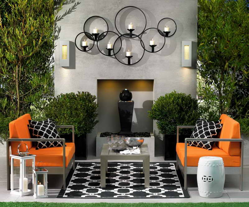 Charmant Retro Style Decoration With Rug And Pillows To Complete Small Patio With  Surprising Candles On Wall