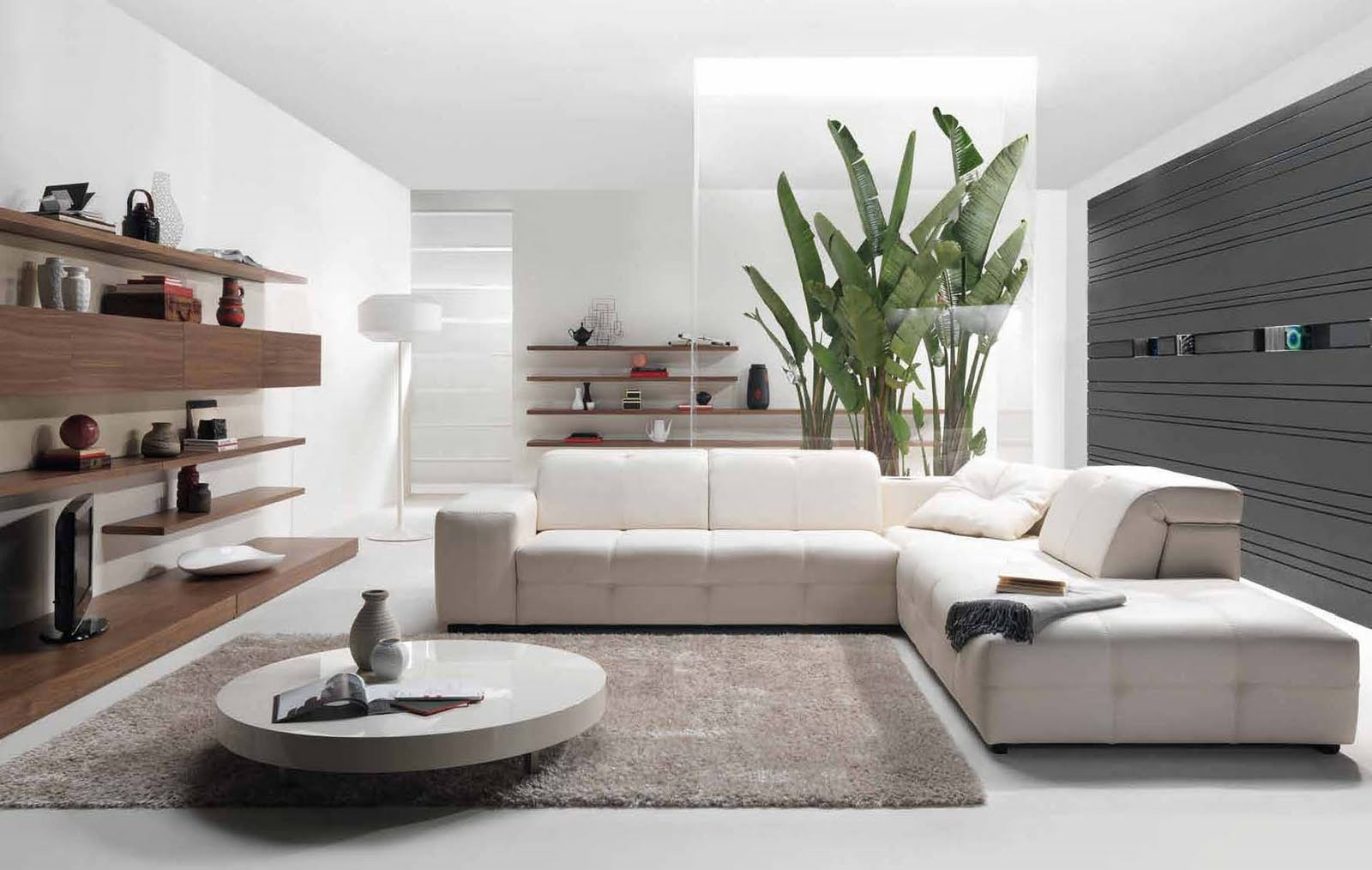 round white coffee table and white sectional sofa on grey carpet rug in simple living room use natural stone wall to decorate