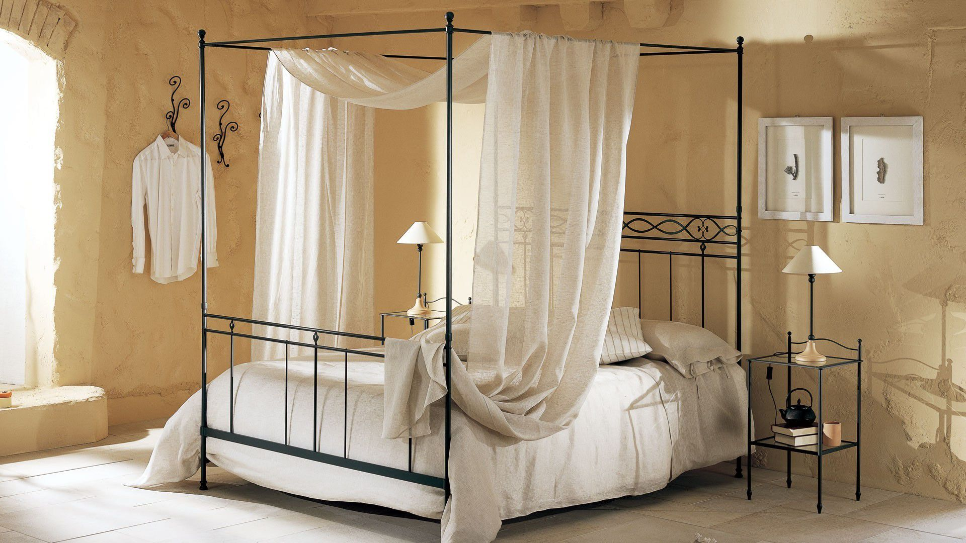 Sheer Curtain Completing Dark Canopy Bed Frame inside Old Fashioned Bedroom with Metal Side Tables