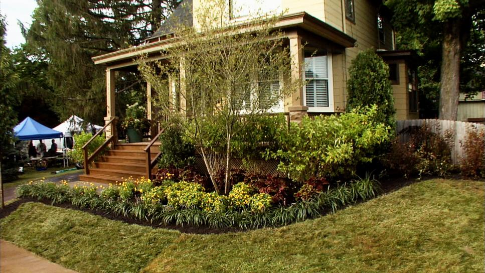 Simple Front Yard Landscaping for Minimalist House Facade with Wooden Stairs and Green Grass Area