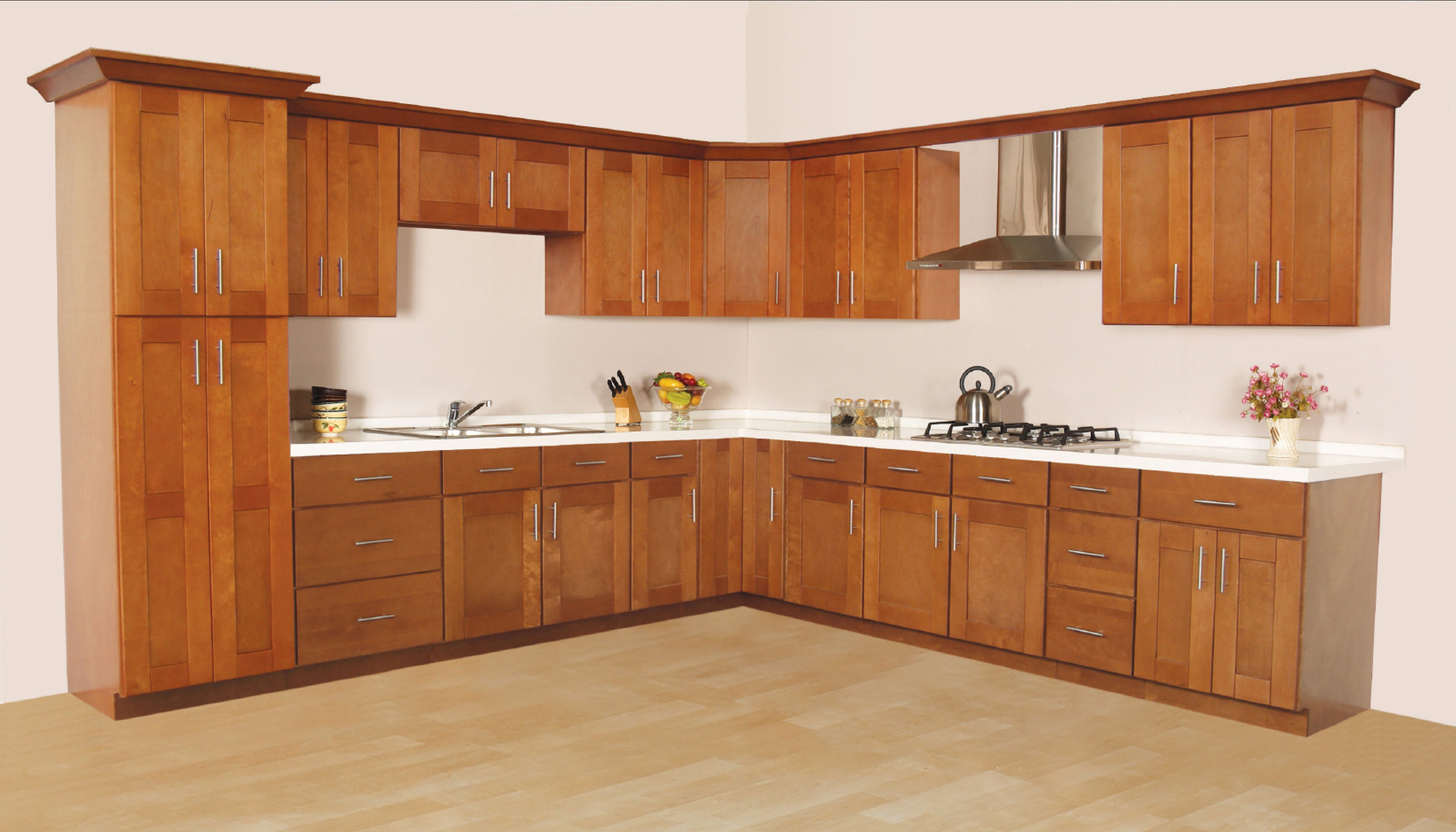 Simple Kitchen Interior with Wooden Cabinets Completed with White Countertop