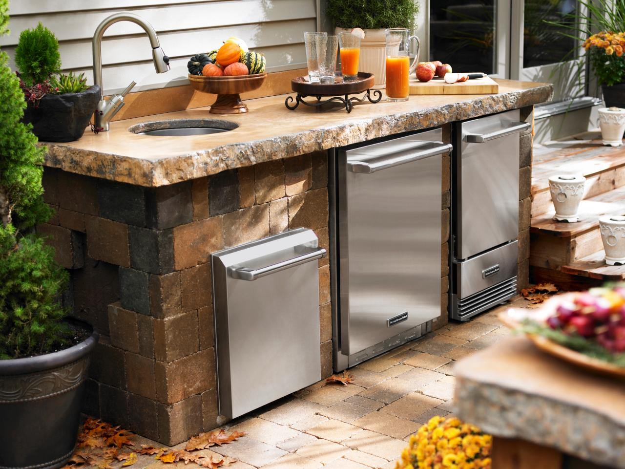 Simple Outdoor Kitchen Design with Stone Cabinet and Countertop Combined with Stainless Steel Storage