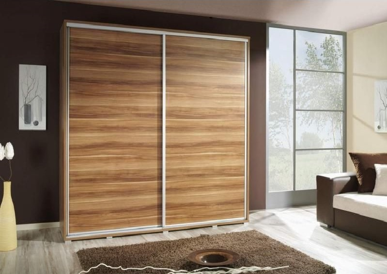 Sleek Closet Door Idea Designed in Sliding Style Made from Wood to Match Neutral Color Scheme