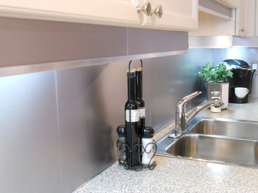 Sleek Kitchen Backsplash Idea Made from Stainless Steel to Meet White Cabinet and Top