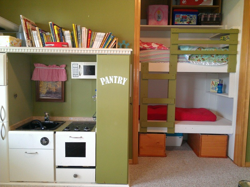 Small Toddler Bunk Beds beside Bookshelf and Pantry Like Playspace on Grey Carpet Flooring