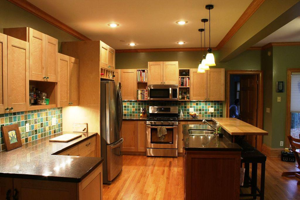 Smart Combination of Maple Kitchen Cabinets with Green Tiled Backsplash